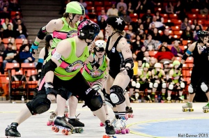 Montreal's Surgical Strike and Jess Bandit give Windy jammer Jackie Daniels a hard time. (Photo by Neil Gunner)