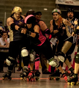 Vicious Dishes pivot Sofanda Beatin puts a hit on Filles du Roi jammer Beth Rave. (Photo by Joe Mac)