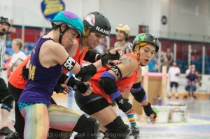 Circle City's Trudy Bauchery (skating for the Diggers) battles Montreal's Nameless Whorror and ToRD's Nasher the Smasher. (Photo by Greg Russell)