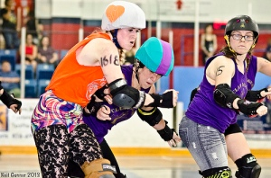 The opening bout was dominated by a Core of Hammer City skaters led by pivot Whacks Poetic (hitting Royal City's Bent Barbie (AKA: Steamy Steelborn). (Photo by Neil Gunner)