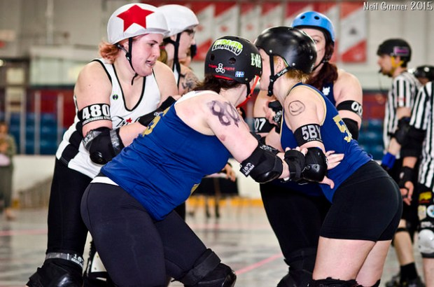 A number of Bruisers  excelled despite playing back-to-back games (including Morton, Joss Wheelin and Tushy Galore) seen here blocking SlaughterHouse Streeter. (Photo by Neil Gunner)