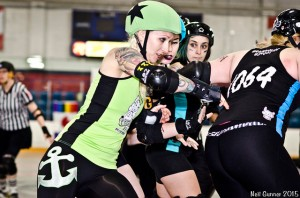 Monster Muffin battles through a Betties wall of Zomboney, pivot Honey Boom Boom, and Brickhouse Bardot. (Photo by Neil Gunner)