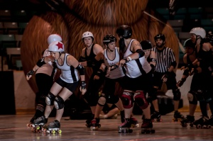 Crazy Squirrel picks up lead jammer status in a May win against Queen City. (Photo by Joe Mac)